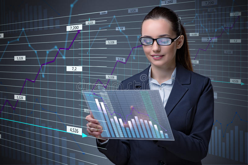 The businesswoman in online stock trading business concept. Businesswoman in online stock trading business concept stock photo