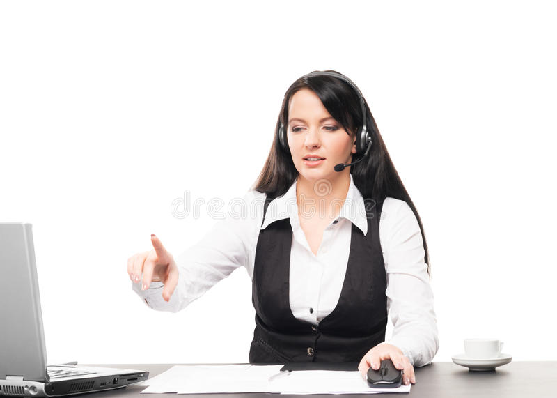 A businesswoman (operator) working in an office royalty free stock photo