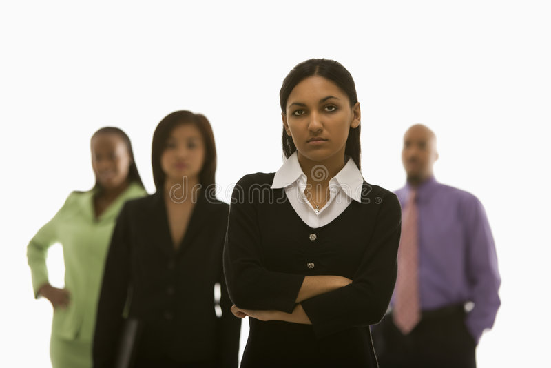 Businesswoman with others stock photo