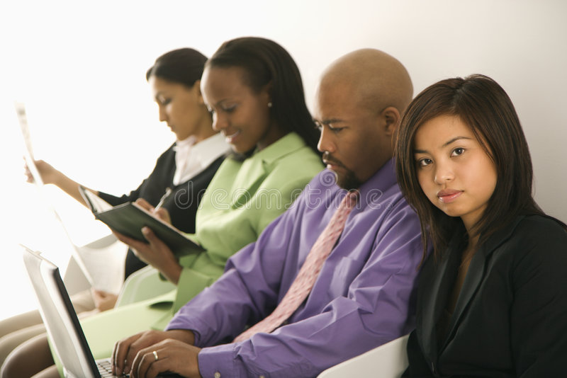 Businesswoman with others stock photography
