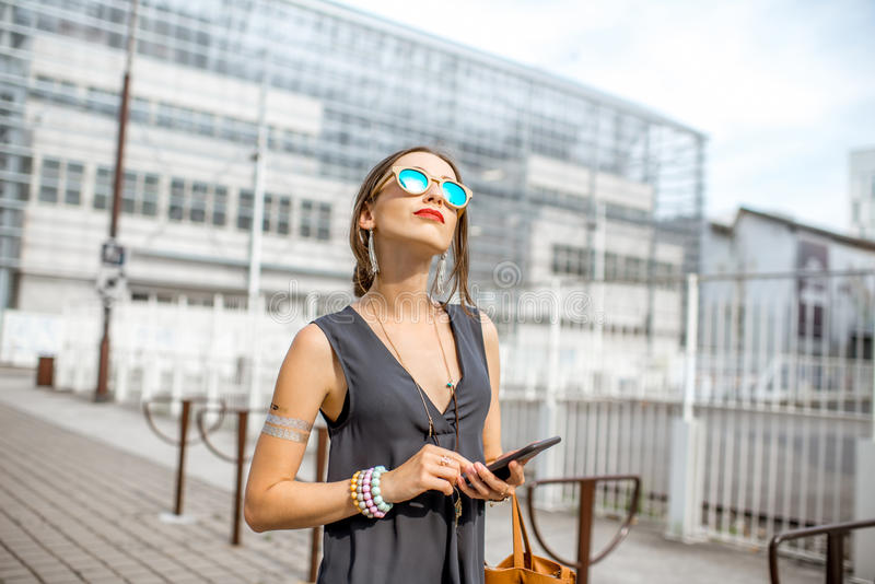 Businesswoman outdoors at the modern office district royalty free stock image