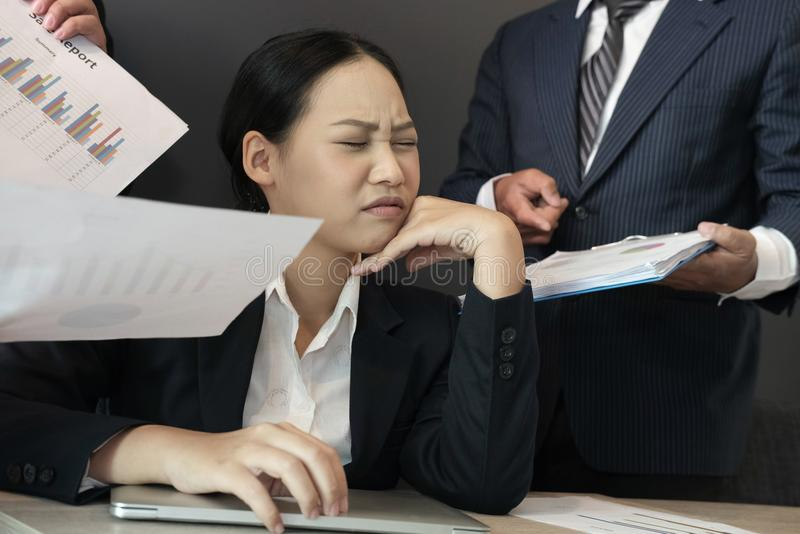 Businesswoman overwhelmed with hard work. overworked woman suffering stress. exhausted secretary burnout royalty free stock photos