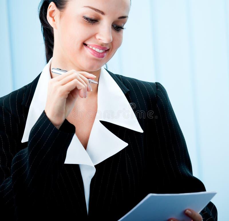 Businesswoman with pen stock photos