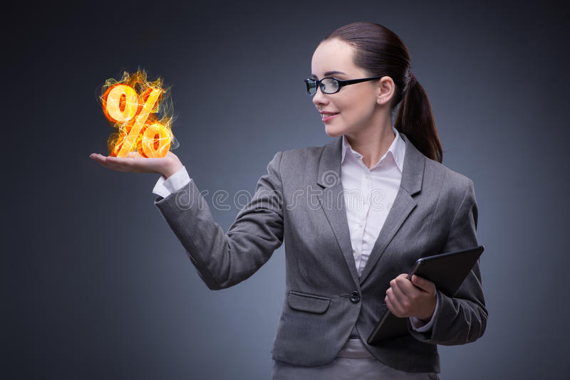 The businesswoman with percent sign in high interest concept. Businesswoman with percent sign in high interest concept stock photo