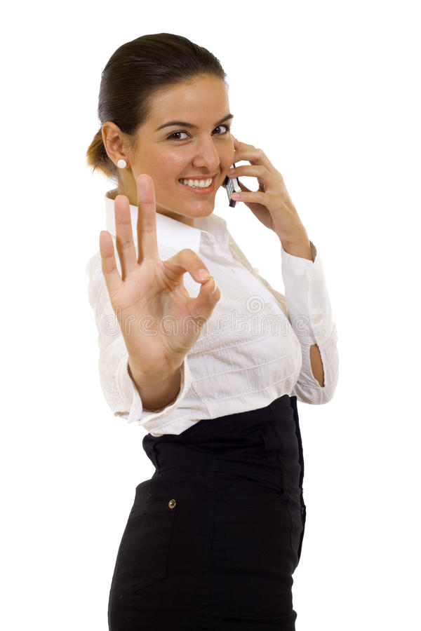 Businesswoman with phone. Happy businesswoman with phone and thumbs up gesture, isolated royalty free stock photos