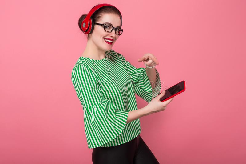 Businesswoman with phone and earphones royalty free stock photography