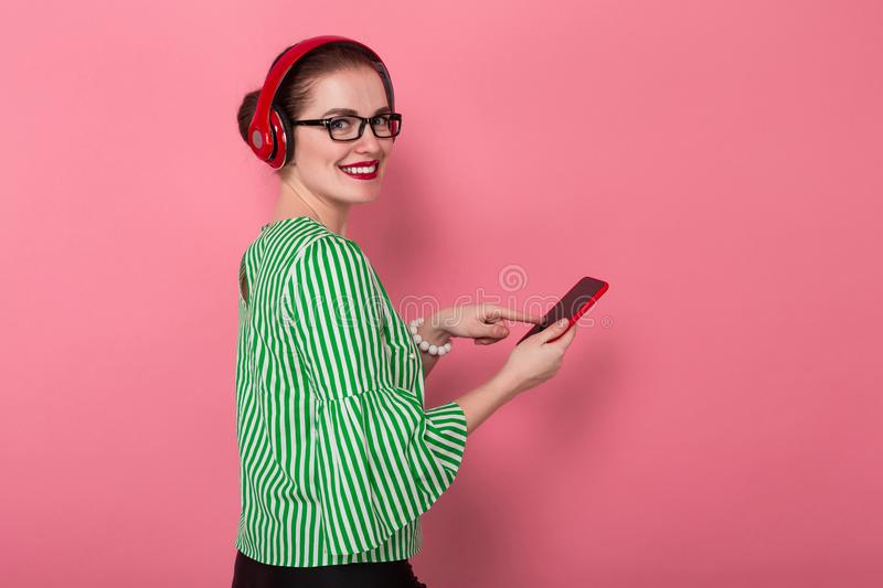 Businesswoman with phone and earphones stock images