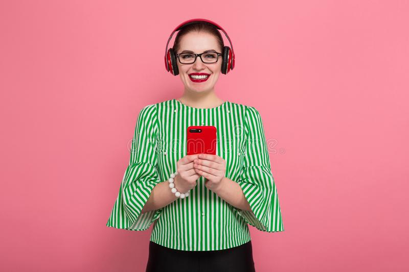 Businesswoman with phone and earphones royalty free stock images