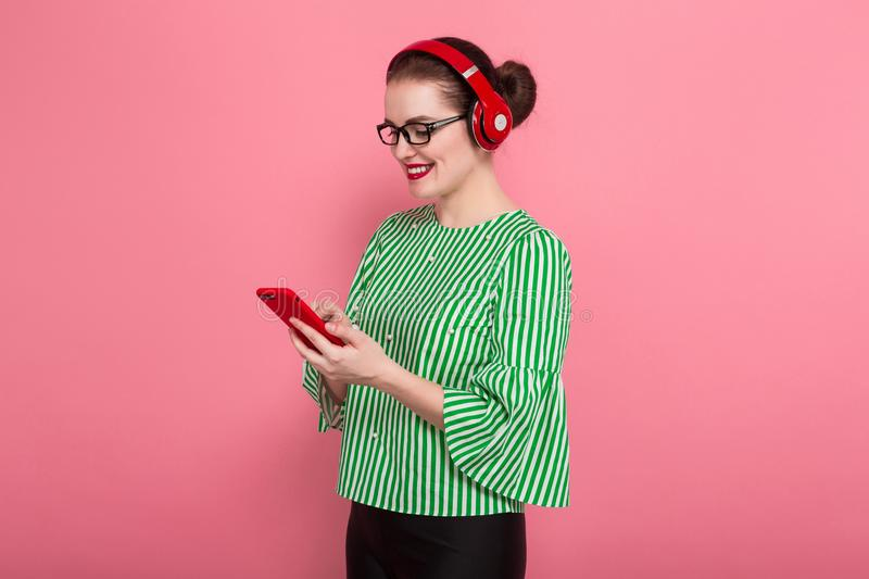 Businesswoman with phone and earphones stock photos