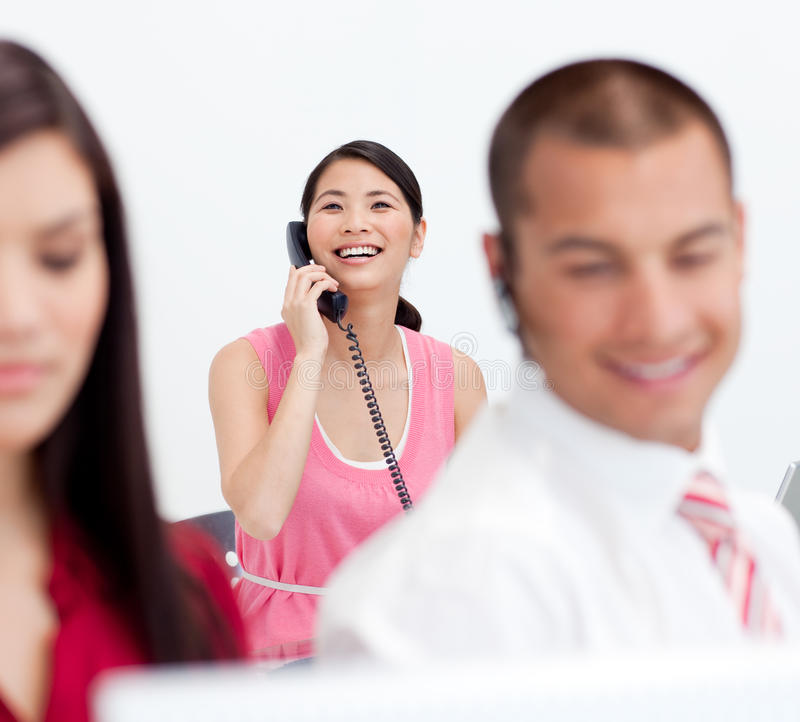 Businesswoman On Phone With Her Colleagues Royalty Free Stock Images