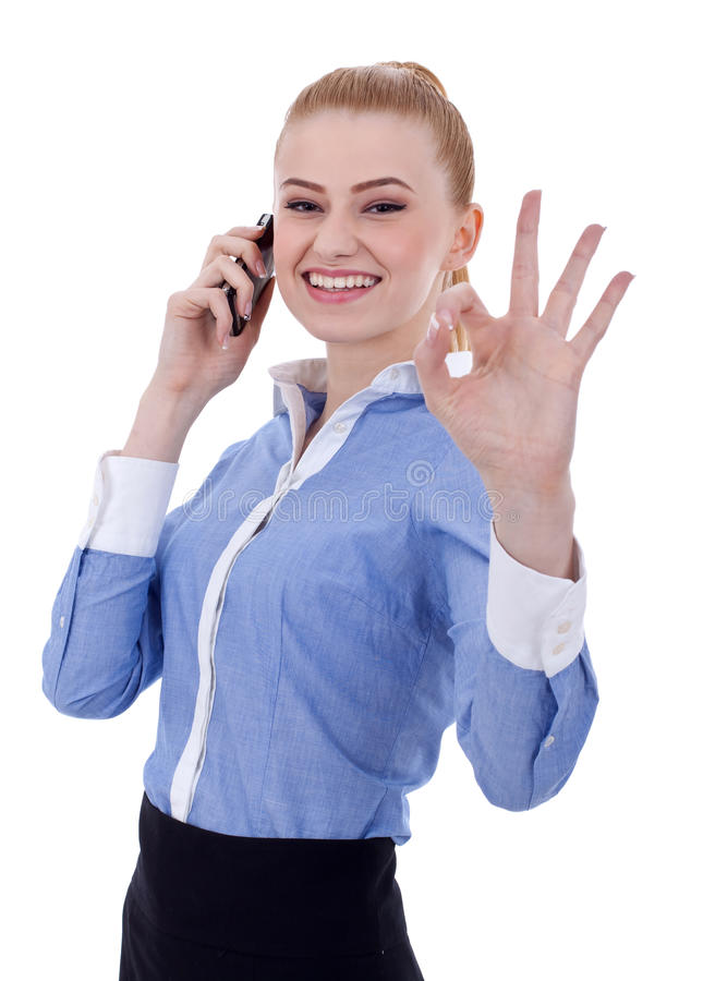 Businesswoman with phone and ok gesture. Happy business woman with phone and ok gesture, isolated stock photography