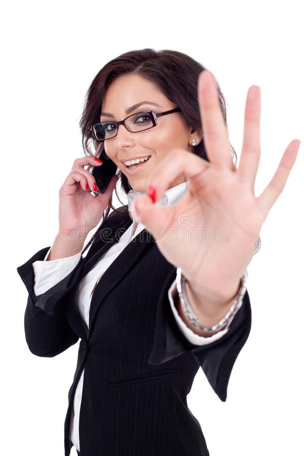 Businesswoman with phone and ok gesture. Happy business woman with phone and ok gesture, isolated stock photos