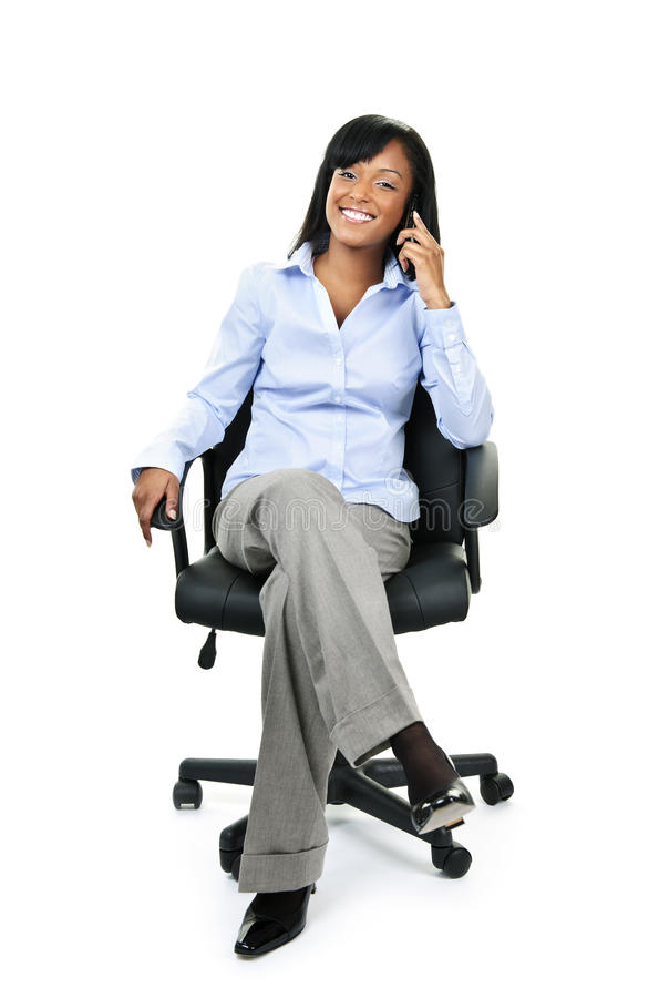 Download Businesswoman On Phone Sitting In Office Chair Stock Image - Image: 17286297