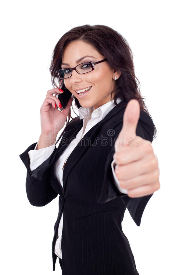 Businesswoman with phone and thumbs up gesture,. Happy business woman with phone and thumbs up gesture, isolated stock images