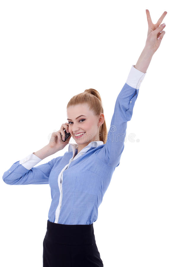 Businesswoman with phone and victory gesture. Happy business woman with phone and victory gesture, isolated royalty free stock images