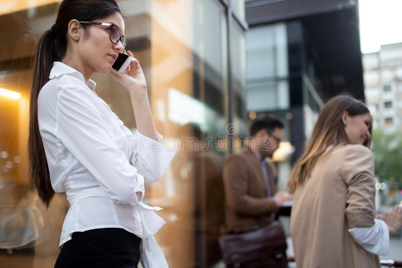Businesswoman on the phone. Woman using her phone on her way from work. stock photography