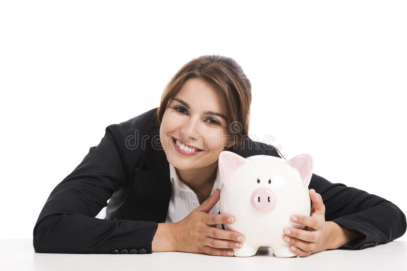 Businesswoman with a piggy bank. Beautiful hispanic business woman holding a piggy bank, isolated over white background stock photography