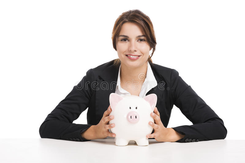 Businesswoman with a piggy bank. Beautiful hispanic business woman holding a piggy bank, isolated over white background stock images