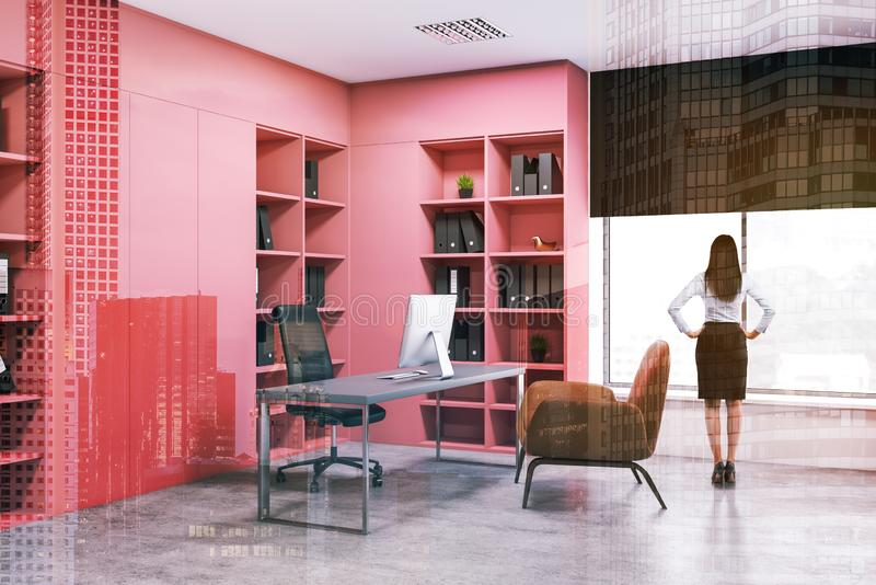 Businesswoman in pink office interior. Rear view of businesswoman standing in modern office with pink bookcases with folders and gray computer desk with armchair royalty free stock image