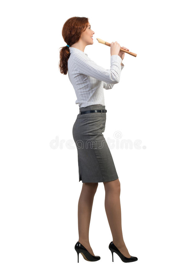 Businesswoman play fife stock photo