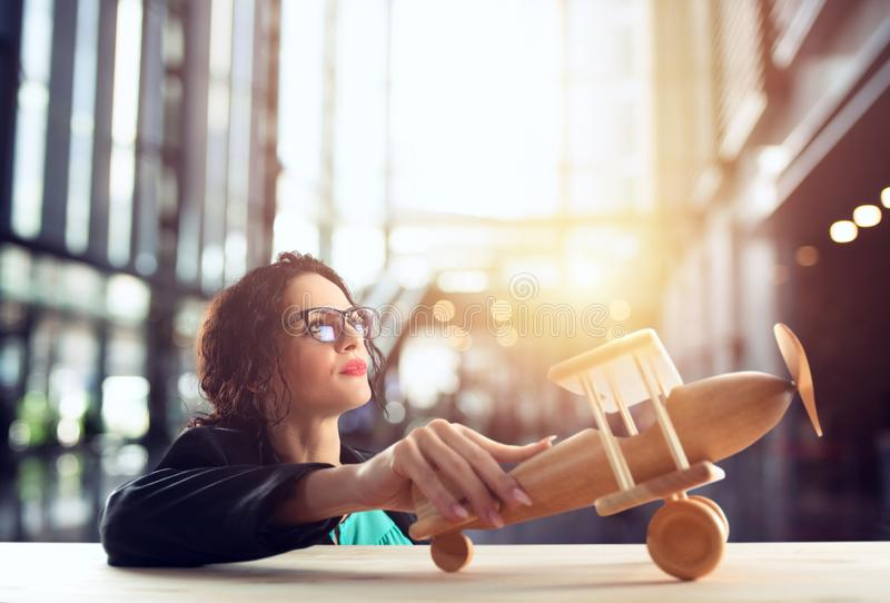 Businesswoman play with a toy aircraft. Concept of company startup and business success. stock photo