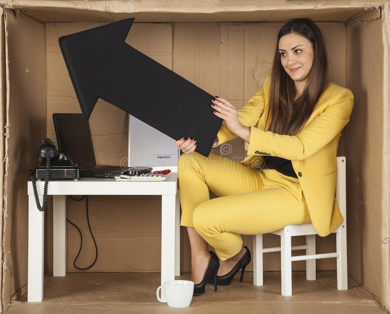 Businesswoman pointing arrow investment growth. Business woman pointing arrow investment growth royalty free stock images