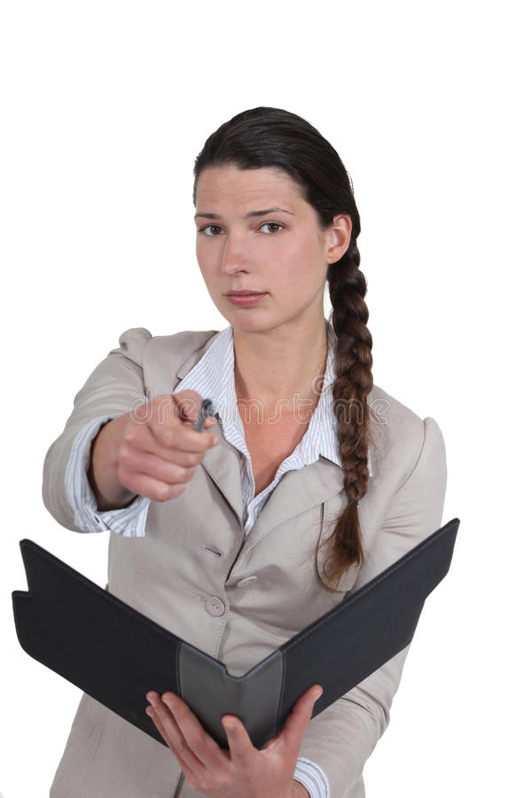 Businesswoman pointing at the camera. stock photos