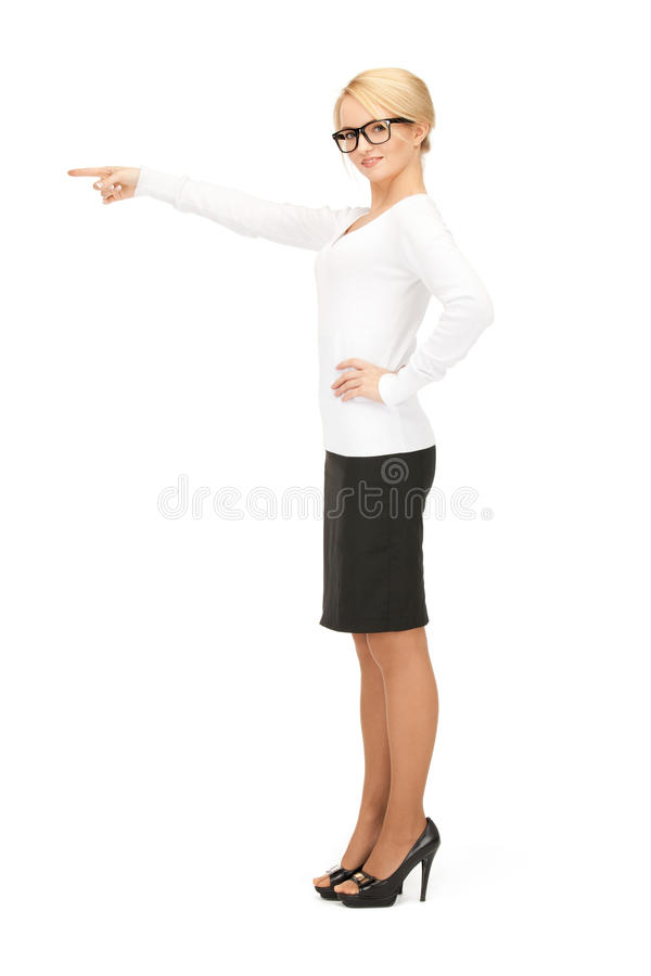 Businesswoman pointing her finger. Picture of attractive businesswoman pointing her finger royalty free stock images