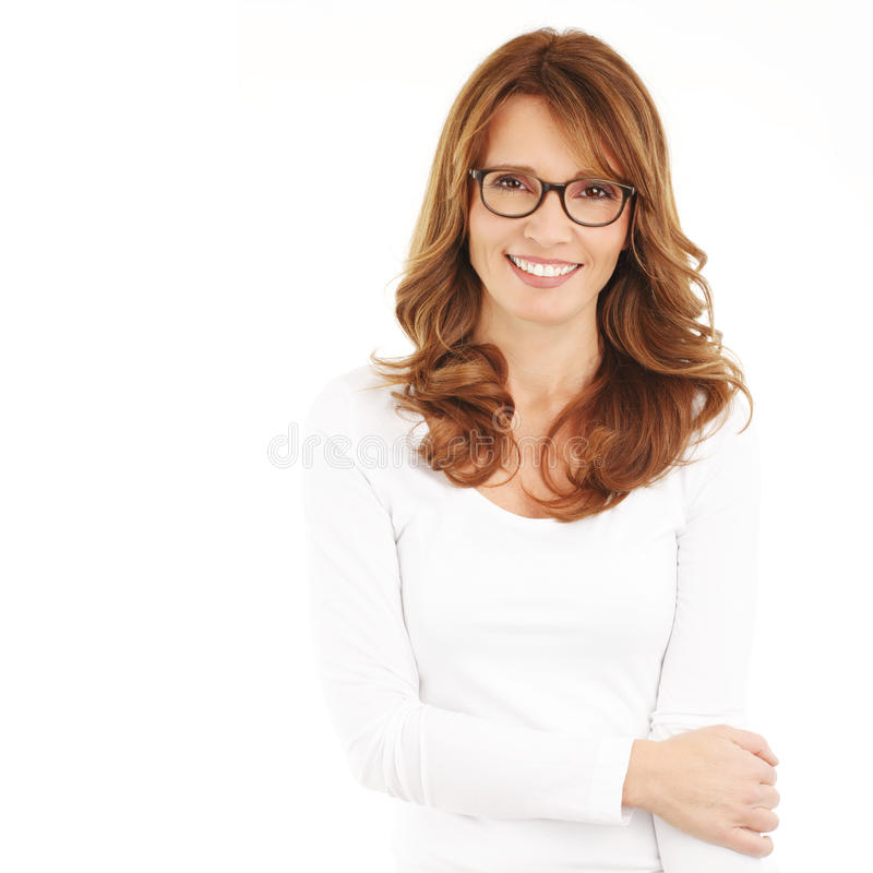 Businesswoman portrait. Middle age businesswoman standing against white background stock photo