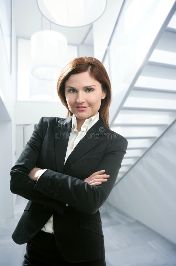 Businesswoman portrait, modern home white stairway stock photo