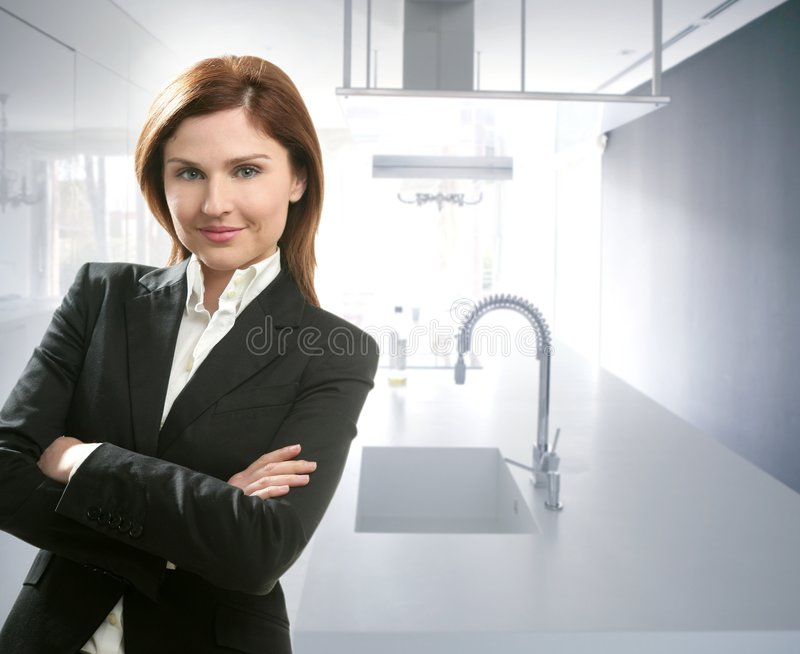 Businesswoman portrait in white kitchen stock images