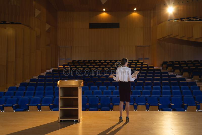 Businesswoman practicing and learning script while standing in the auditorium stock photos