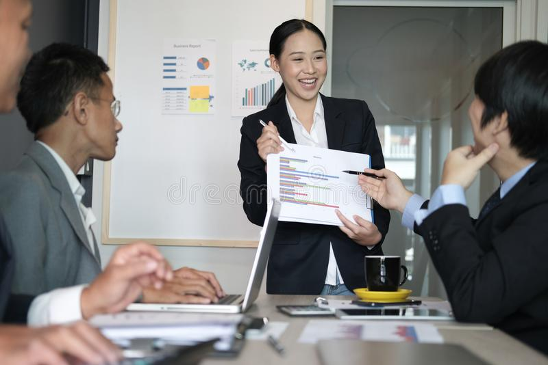 Businesswoman present financial plan report to co worker team. w royalty free stock photography