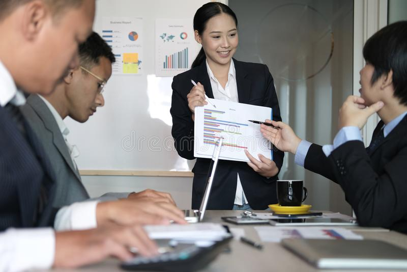 Businesswoman present financial plan report to co worker team. w stock photography