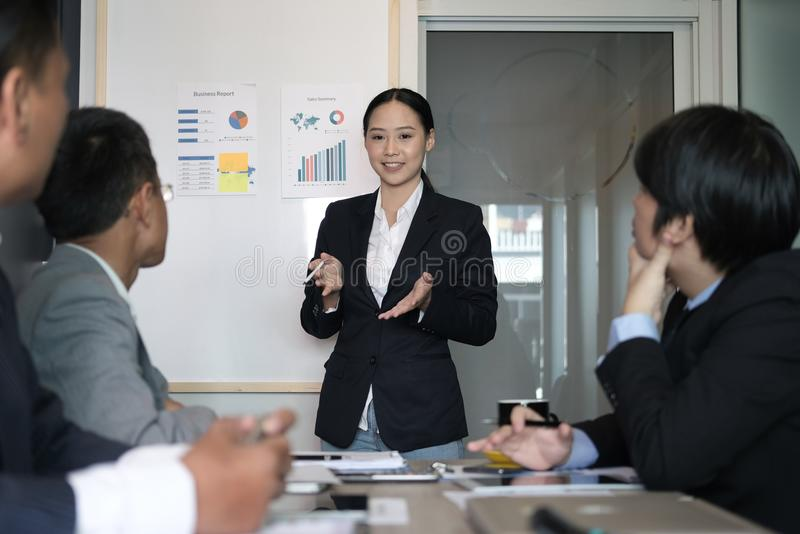 Businesswoman present financial plan report to co worker team. w royalty free stock image