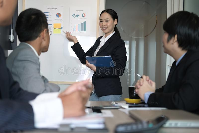 Businesswoman present financial plan report to co worker team. w royalty free stock photos