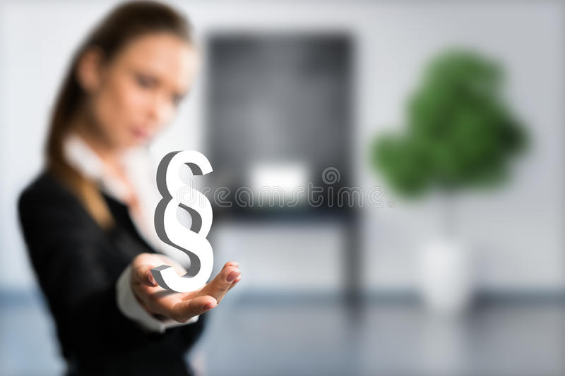 Businesswoman presenting a paragraph in front of a workspace. With a chalkboard royalty free stock images