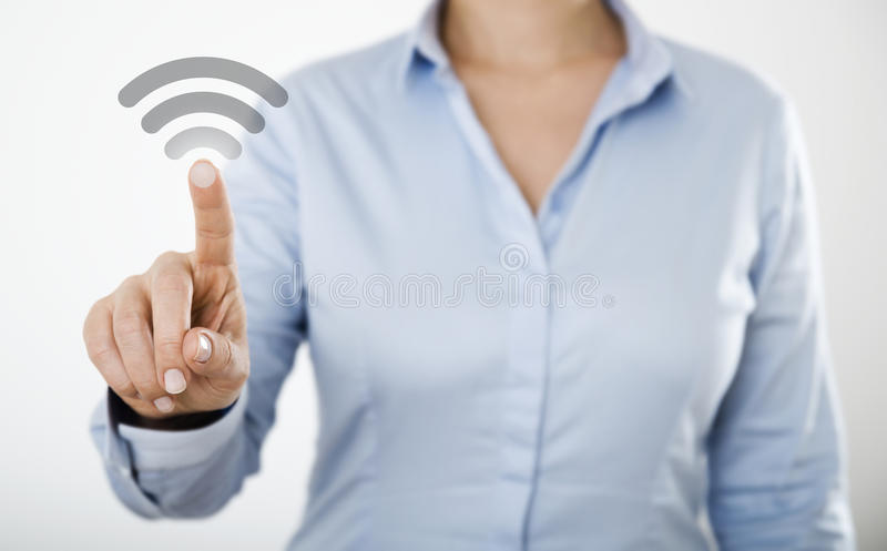 Businesswoman pressing button on the digital touch screen stock photos