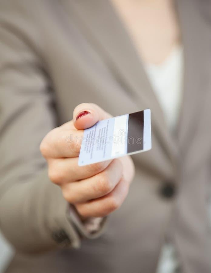 Businesswoman proposing plastic card. Closeup shot royalty free stock images