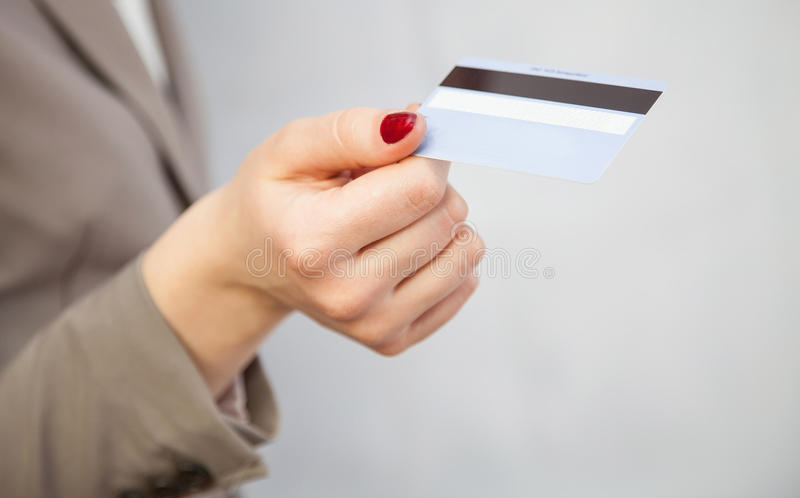 Businesswoman proposing plastic card. Closeup shot stock images