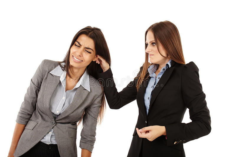 Businesswoman Pulling Colleague S Ear Stock Photos