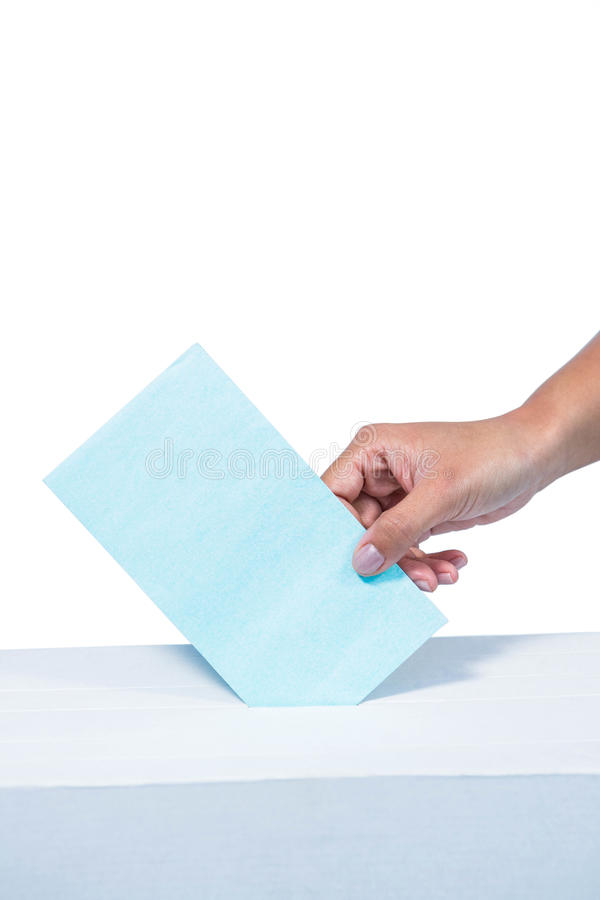 Businesswoman putting ballot in vote box. On white background stock image