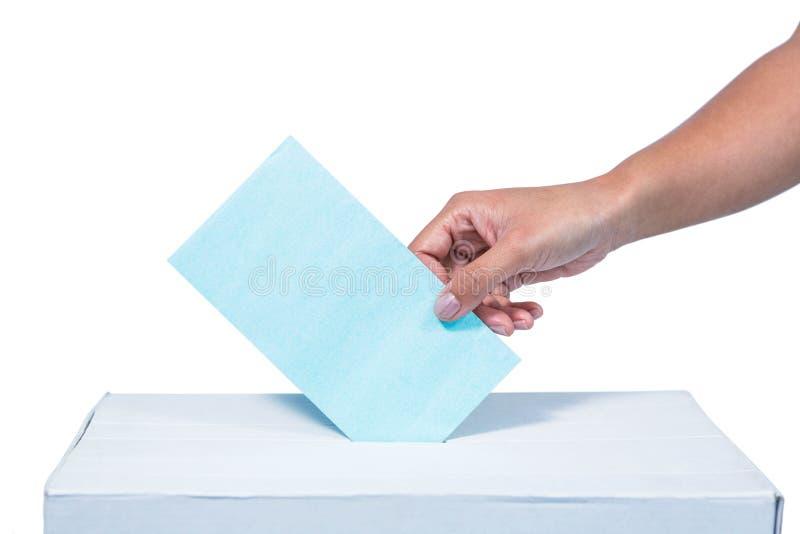 Businesswoman putting ballot in vote box. On white background stock photo