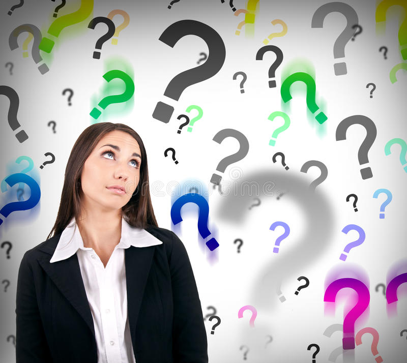 Businesswoman with question marks stock images