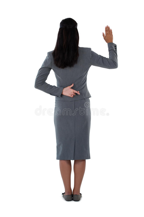 Businesswoman raising her hand royalty free stock photography