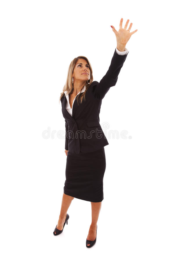 Businesswoman reaching something royalty free stock photo