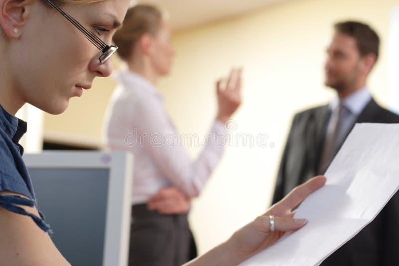Businesswoman Reading Document stock photos