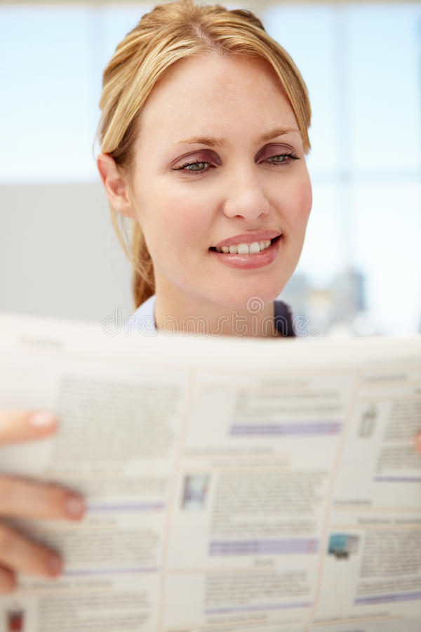 Download Businesswoman Reading Document Stock Photography - Image: 21285822