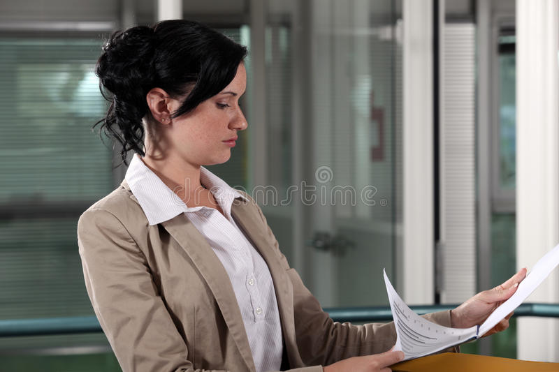 Businesswoman reading a document royalty free stock image