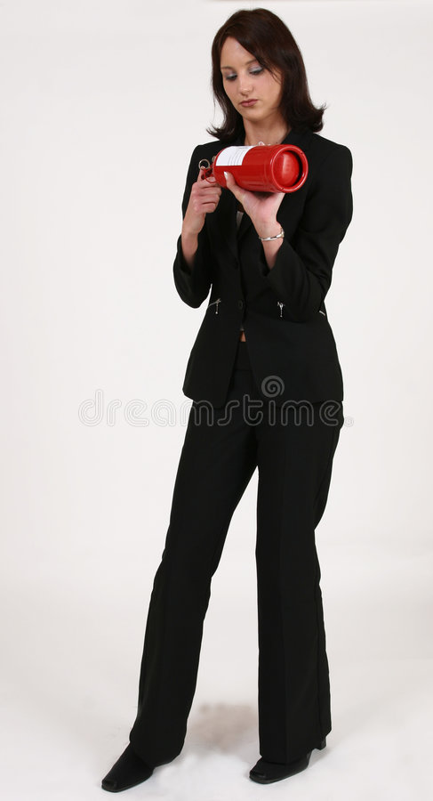 Download Businesswoman Reading Instructions On Fire Extinguisher Royalty Free Stock Photo - Image: 219855